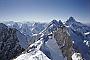 The summit eyrie of Gasherbrum II, 29 July 1996. Broad Peak and K2 behind.