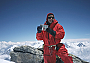 The summit of Dhaulagiri, 17 May 2004, holding a photo of my daughter Fiona and grandson Jay.