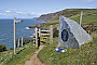 A plaque near the Urdd Centre marks the official opening of the Ceredigion Coast Path (Day 13)